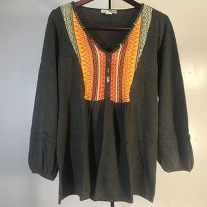 Gray Blouse with multicolor embroidery.